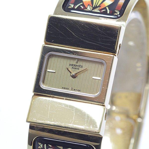 ブレスレット感覚でお使い頂ける HERMES エルメス レディース腕時計 ロケ バングルウォッチ LO1.210 GP/七宝 ゴールド文字盤 クォーツ【中古】